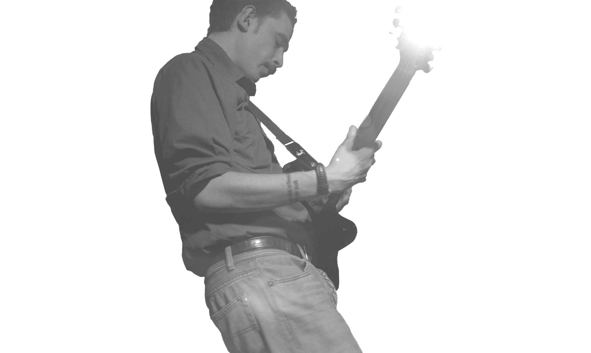 Sytlish black and white photo of musician/composer Marc Wencelius playing the electric guitar. Photo credited to Musicos Productions. Design by Musicos Productions